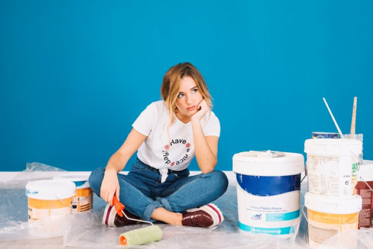 girl sitting paint materials